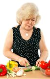 Old woman cooking food Royalty Free Stock Photo