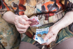 Old woman counting her money Royalty Free Stock Photos