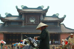 An old woman is counting money in front of the Bai Dinh Pagoda, one of the biggest in the southern east asia Stock Image