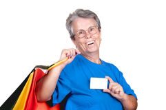 Old woman with credit card and bags Royalty Free Stock Photo