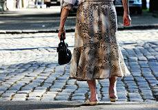 Old Woman Crosses the Street Royalty Free Stock Photo