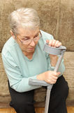 Old woman with crutch Royalty Free Stock Photo