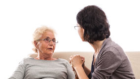Old woman cry shocked hand consoled Royalty Free Stock Photography