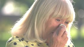 Old woman crying. Lady wiping tears with napkin. No joy in life. Feel weak and miserable stock video footage