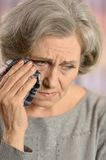 Old woman crying Stock Images