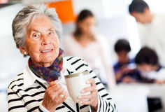 Old woman with a cup of tea Royalty Free Stock Image