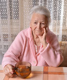 Old woman with cup of tea Royalty Free Stock Photo