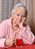 Old woman with cup of tea Stock Image