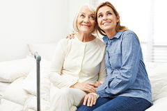 Old woman and daughter looking up Royalty Free Stock Photos