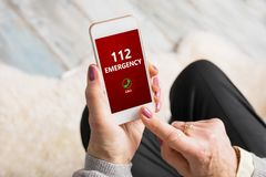 Old woman dialing emergency number 112 on phone. Emergency call concept Stock Photos