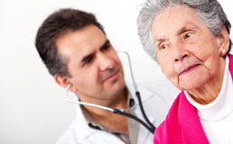 Old woman at the doctor Stock Photo