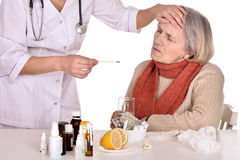 Old woman with doctor Stock Image