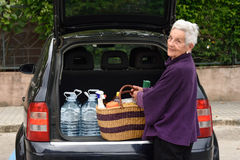 Old woman downloading the car Royalty Free Stock Photography