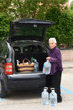 Old woman downloading the car Royalty Free Stock Photos