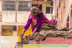 An old woman dried cow dung. For a camp fire in Varanasi, India Stock Photos