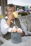Old woman drinking coffee Royalty Free Stock Image