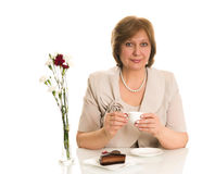 Old woman drinks coffee Stock Photography
