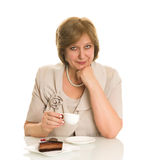 Old woman drinks coffee Royalty Free Stock Images
