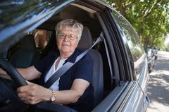 Old woman driving car Royalty Free Stock Image