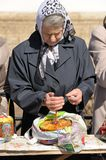 Old woman with easter kulitch and candle in Spaso-Uspensky monas Stock Images