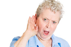 Old woman eavesdropping Royalty Free Stock Photography