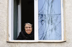 Old woman elderly window looking smile Royalty Free Stock Photography