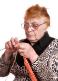 The old woman is engaged in knitting Stock Photos