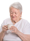 Old woman enjoying coffee or tea cup Royalty Free Stock Photos