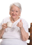 Old woman enjoying coffee or tea cup Stock Photography