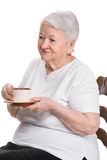 Old woman enjoying coffee or tea cup Stock Photo