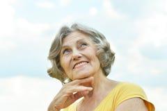 Old woman enjoying a walk Royalty Free Stock Photo