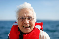 Old woman enjoys a boat ride Royalty Free Stock Photo