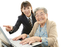 Old woman enjoys laptop computer Royalty Free Stock Photo