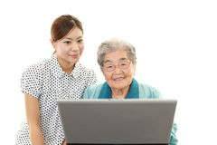 Old woman enjoys laptop computer Royalty Free Stock Images