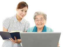 Old woman enjoys laptop computer Stock Photo
