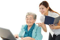 Old woman enjoys laptop computer Royalty Free Stock Image