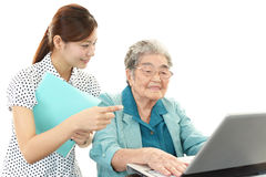 Old woman enjoys laptop computer Royalty Free Stock Photos