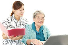 Old woman enjoys laptop computer Stock Photography