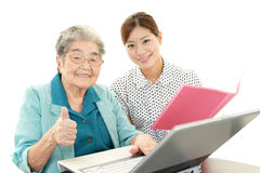 Old woman enjoys laptop computer Royalty Free Stock Photography
