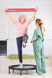Old woman exercising with latex band Royalty Free Stock Image