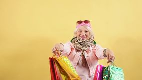 Old woman expresses positive emotion, does the shopping at weekend. Gorgeous pretty old woman expresses positive emotion, does the shopping at weekend. Holiday stock video footage