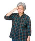 Old woman feel headache Stock Photography