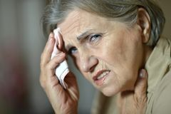 Old woman feel unwell. Portrait of an old woman feel unwell stock photography