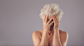 Old woman feeling shy Royalty Free Stock Photos