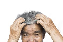 Old woman felt a lot of anxiety about hair loss issue on white background. Scalp problem concept Stock Images