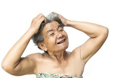 Old woman felt a lot of anxiety about hair loss and itching dandruff issue. On white background, scalp problem concept Stock Images