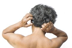 Old woman felt a lot of anxiety about hair loss and itching dandruff issue. On white background, scalp problem concept Royalty Free Stock Images