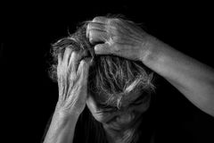 Old woman felt a lot of anxiety about hair loss and itching dandruff. Issue on black background, scalp problem concept Royalty Free Stock Photography