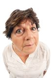 Old woman fisheye portrait. Close-up of woman standing over white background.  Shot with fisheye lens Royalty Free Stock Photo