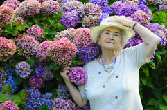 Old woman with flowers royalty free stock photo